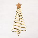 Рождественская елка сделанная золотых sparkles Стоковые Изображения