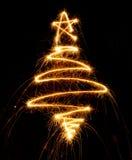 Рождественская елка сделанная с бенгальским огнем на черноте Стоковая Фотография RF