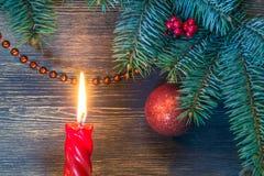 Рождественская елка с накаляя свечой и голубым самым интересным Стоковое Изображение