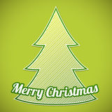 Рождественская елка striped зеленым цветом на зеленой предпосылке Стоковые Фото