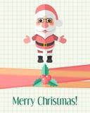 Рождественская открытка с Санта Клаусом над страницей тетради с прописями Стоковое фото RF