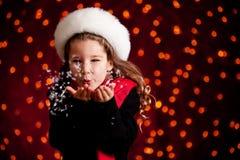 Рождество: Дуя пригорошня снега Стоковое Изображение