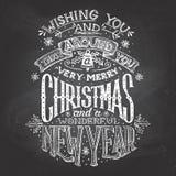 Рождество желает рук-литерность с мелом Стоковые Изображения