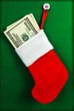 Рождество запасая вполне счетов 100-доллара Стоковое Фото