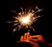 Рождество и newyear бенгальский огонь партии на черноте Стоковое Изображение RF