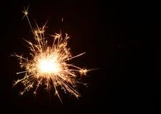 Рождество и newyear бенгальский огонь партии на черноте Стоковое Фото