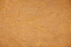 рождество предпосылки золотистое бумажная текстура Стоковое фото RF