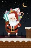 Рождество Санта Клаус на крыше Стоковые Фото