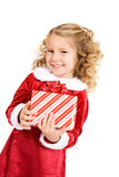 Рождество: Счастливым подарок ребенка праздника обернутый удерживанием Стоковая Фотография RF