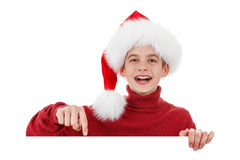 Рождество, Xmas смеясь над Сантой показывая пустой знак афиши Стоковое фото RF