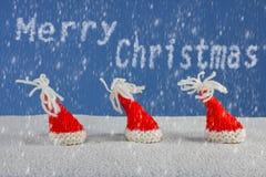 Рождеств-шляпы и снег Стоковые Изображения