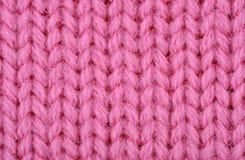 Розовая вязать текстура шерстей Стоковое Фото