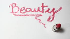 Розовая губная помада на белой предпосылке стоковое изображение rf