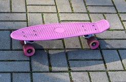 Розовая доска пенни стоковая фотография