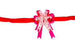 Розовая лента смычка на белой предпосылке Стоковое Фото