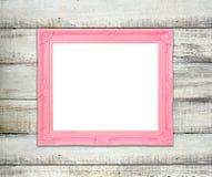 Розовая картинная рамка сбора винограда на голубой деревянной предпосылке Стоковая Фотография
