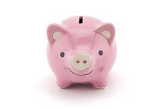 розовая керамическая изолированная копилка на белой предпосылке Стоковые Фото