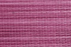Розовая поверхность циновки соломы цвета Стоковые Изображения