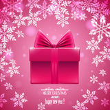 Розовая предпосылка с снежинками и подарком, Стоковое Фото