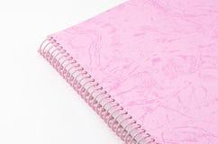 Розовая тетрадь изолированная на белизне Стоковые Фотографии RF