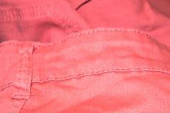 Розовая ткань джинсов Стоковые Изображения