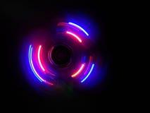 Розовая фиолетовая волна круга в темной предпосылке Стоковые Фото