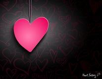 Розовое бумажное сердце на черных обоях Стоковое Изображение RF