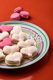 Розовое и cream macaron на оранжевой предпосылке Стоковое Фото