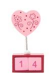 Розовое сердце на весне над календаром показывая 14 Стоковая Фотография RF