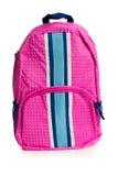 Розовой рюкзак поставленный точки полькой на белизне Стоковые Фото