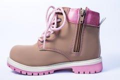 Розовые ботинки детей на белизне Стоковые Фотографии RF