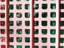Розовые и зеленые пластичные корзины Стоковое фото RF