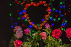 Розовые цветки в предпосылке сердца Стоковые Изображения