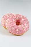 Розовые donuts с sprincles на белизне Стоковое Изображение RF
