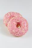 Розовые donuts с sprincles на белизне Стоковое Фото
