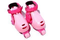 розовые rollerskates Стоковые Изображения