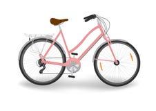 Розовый велосипед ` s женщин Стоковая Фотография