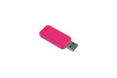 Розовый изолированный ключ USB стоковая фотография