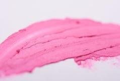 Розовый мазок губной помады на предпосылке Стоковое Изображение