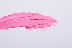 Розовый мазок губной помады на предпосылке Стоковые Фотографии RF