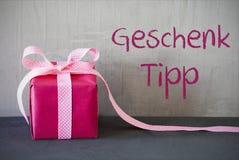 Розовый настоящий момент, Geschenk Tipp значит подсказку подарка Стоковые Изображения RF