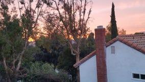 Розовый оранжевый заход солнца стоковое фото