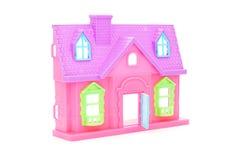 Розовый пластичный кукольный дом с раскрытой дверью стоковое изображение rf