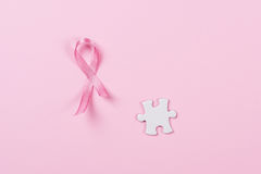 Розовый рак молочной железы частей ленты и головоломки Стоковые Изображения