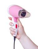 Розовый фен для волос в руке Стоковое Фото