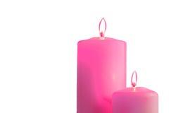 2 розовых горящих свечи на белой предпосылке Стоковые Изображения