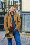 розы человека красные молодые стоковое фото rf