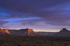 Рокируйте долину на заходе солнца, трассу 128 Moab Юты Стоковое Изображение RF