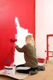 ролик краски девушки Стоковые Фото