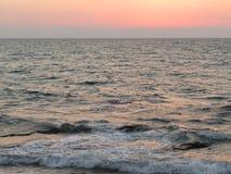 Романтичный заход солнца на море Стоковое Изображение RF